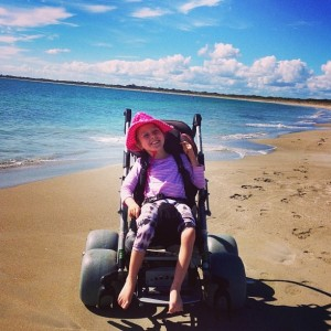 Enjoying the beach in a beach wheelchair