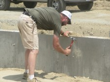 August 2, 2011 Pastor Bill working on insulating the foundation walls.