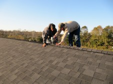 10/25/11 Dave & Brian putting shingles over the ridge vent.