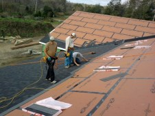 10/20/11 Jason Weaver, Pastor Bill, & Brannon putting up shingles.