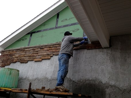12/23 Mason putting up last sill plate on that ledge