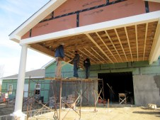 11/25/11 Pastor Bill, Dave, Tommy, & Bob putting up faren strips on the carport.