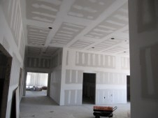 3/26/12 view from hallway to SS wing looking into vestibule and farther into fellowship hall, all taped & mudded