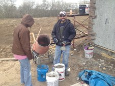 4/2/12 Chris filling Hannah's bucket with mortar