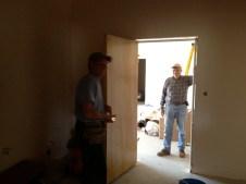 4/16/12 Gordon Johnston and Tommy Goodfellow installing the men's restroom door to the vestibule.