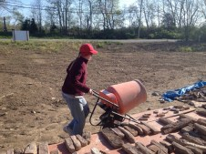 4/25/12 Christy getting the mortar mixer ready for Michaela to make a batch