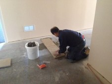 4/28/12 Gary laying the starter row of tile.