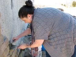 4/7/12 Danielle Crain putting up a stone