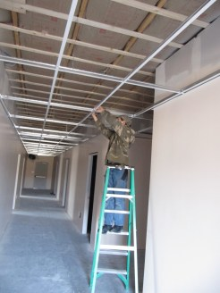 4/12/12 Billy helping John put up the acoustic ceiling.