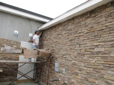 4/18/12 Chris Kairnes putting up the last stone of that wall!!!!! YAY!