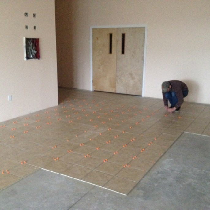 5/1/12 Vestibule tile so far. Color: Sahara Beige from Surface Solutions