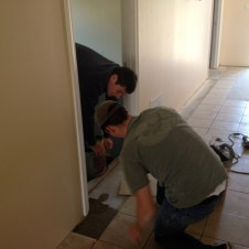 5/7/12 Jonathan & Brannon laying tile in the SS wing