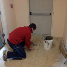 5/8/12 Jonathan Miller putting the last tile in, or so he thought!