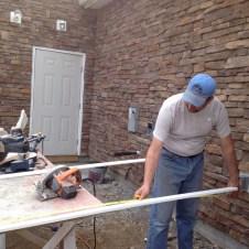 5/14/12 Pastor Bill cutting a baseboard