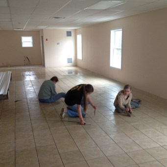 5/21/12 Christy, Hannah, & Anna scraping the thin-set in preparation for grout