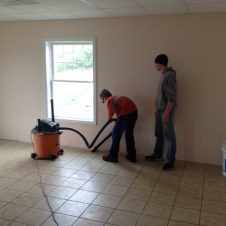 5/21/12 Devan & Brannon cleaning in preparation for grout