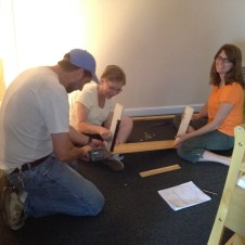 5/30/12 Mrs. Sue and Tammy putting the crib together. Pastor Bill wanted to help, so they let him.