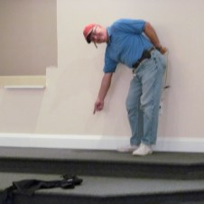 7/7/12 Tommy Goodfellow working on the baseboards