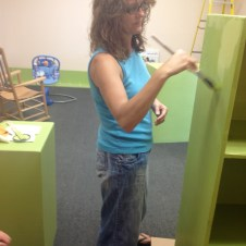 7/10/12 Tammy putting the finish coat on the nursery shelf