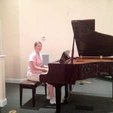 "7/11/12 Christy playing ""Jesus Loves Me"""