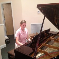"7/11/12 Christy playing ""Happy Birthday"" to Tabetha–first song on the piano in the new church! :)"