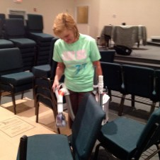 7/16/12 Gaye Nobles vacuuming the chairs