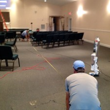 7/16/12 Pastor Bill & Mr. Warner getting a straight line for the chairs
