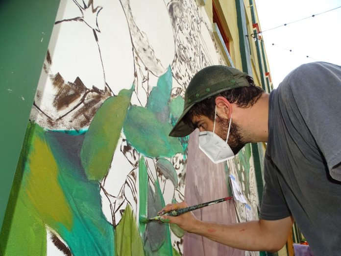 <p><p>Jeremy Canova, during the early stages of painting.</p><p>BEACON PHOTO/MARSHA MCLAUGHLIN</p>