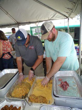 <p><p>Matt Brown and Kurt Luman prepare to fry</p></p><p></p>