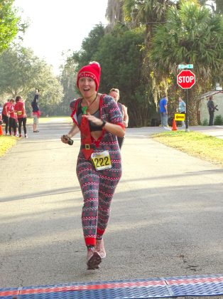 <p><p><strong>ALL DRESSED UP</strong>— An enthusiastic Maria Pecoraro-McCorkle runs the course. The race website lists her as finishing in 233rd place.</p></p><p>BEACON PHOTO/MARSHA MCLAUGHLIN</p>