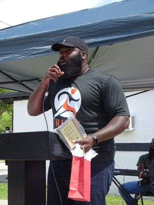 Award recipient R.J. Simpson, for his work with the DeLand Dawgs and the TRUST program.