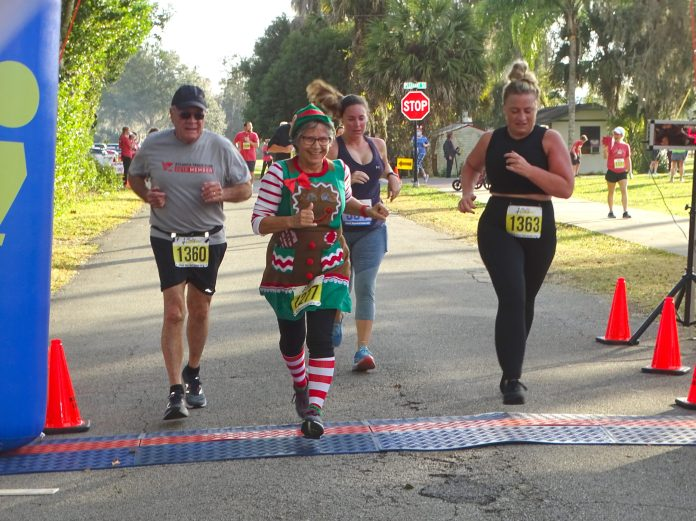 <p><p><strong>THE FINISH LINE</strong>— From left, Malcolm Johnson, Marieann Bannan and Rachel Johnson cross the finish lines in the Lake Helen Holiday Stress Buster 5K on Christmas Eve. The three finished in 258th, 254th and 259th place, respectively, according to results published on the official race website.</p><p>BEACON PHOTO/MARSHA MCLAUGHLIN</p>