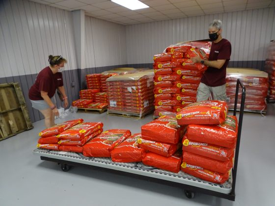 <p><p>A small sampling of the hundreds of pounds of pet food given away to owners at the event. Pictured here, volunteers Renee Schoen and Mark Peterka.</p></p><p></p>