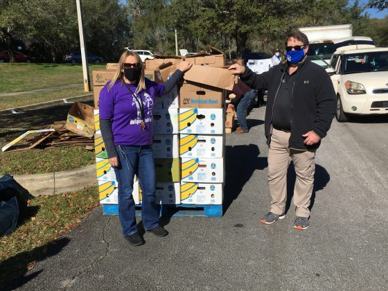 <p><p>HELPING TOGETHER — Orange City Vice Mayor Kelli Marks, left, and Council Member Jeff Allebach, right, prepare to begin loading cars with donated foodstuffs. Marks established Backpack Buddies, a tax-exempt nonprofit organization dedicated to relieving hunger in the Orange City area.</p></p><p></p>