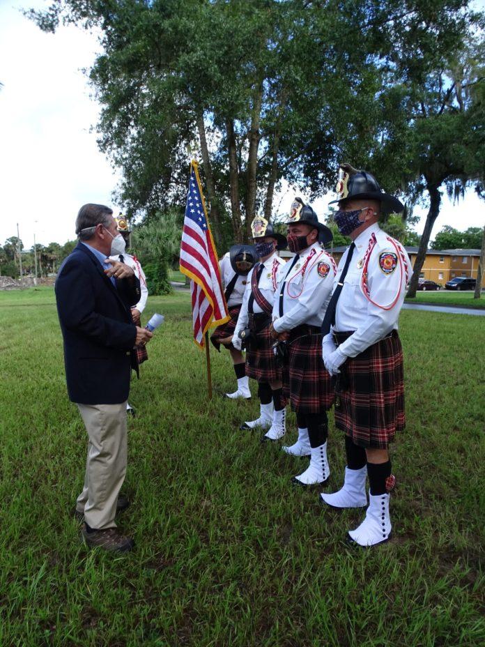<p><p>DeLand Mayor Robert Apgar with members of the DeLand Fire Department.</p></p><p></p>