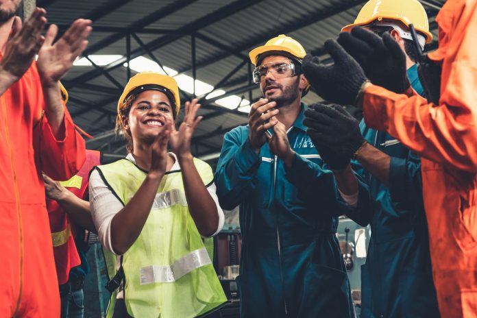 Workers celebrate at factory