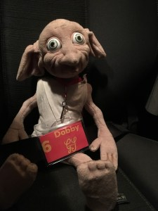 Dobby wearing his Gang Show ID with his number