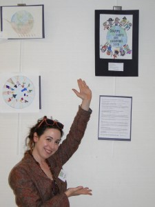 Andrea Zoppo shows off the wining design which is on display at the Decatur Library.