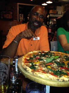 Greg White sampling a healthy pizza at Sapori di Napoli during Eat Well Indie-Catur