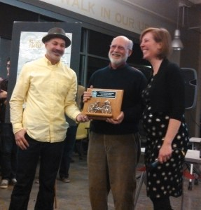 "Fred  Boykin accepts the ""Blinkie"" Award from Rebecca Serna of the Atlanta Bicycle Coalition."