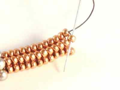 Learn to make the delicate Mixed Metals Bracelet using Tubular Herringbone Stitch.