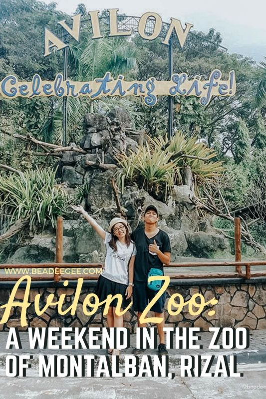 a couple in from of a signage avilon Zoo in montalban rizal