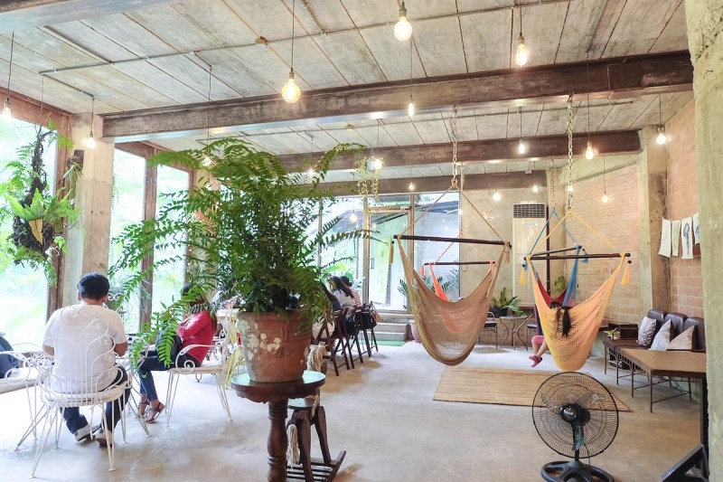 tables on the other side while there's hammocks on the other in burrow cafe antipolo