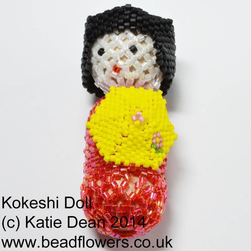 beaded kokeshi doll