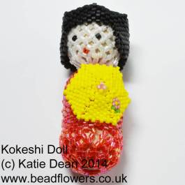 beaded kokeshi doll