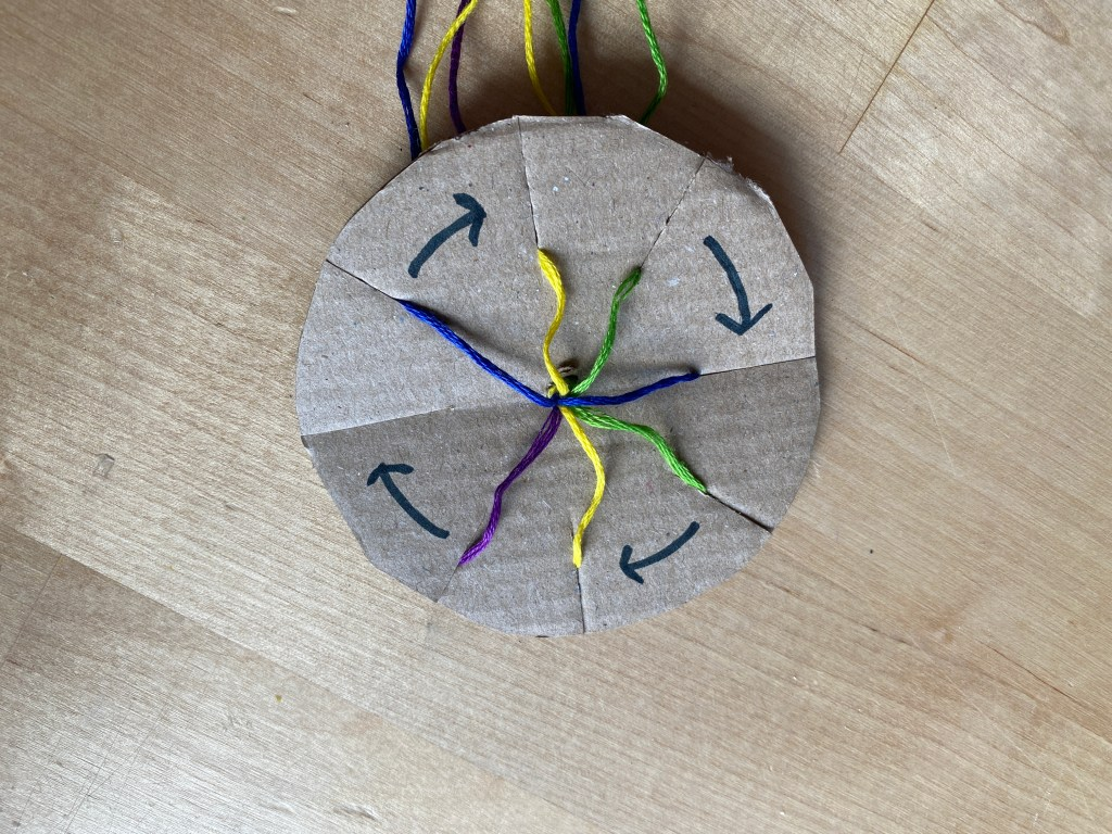 cardboard braiding - arrange your threads into the notches