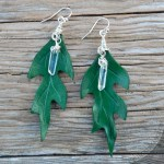 Green oak leather leaf earrings with titanium quartz and sterling silver.