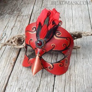 Handcrafted leather bird mask.
