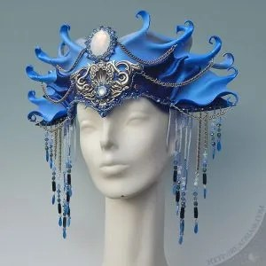 sculpted leather headdress, embellished with hand sewn beadwork with Swarovski crystals and vintage glass cabochons