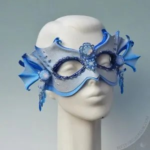 sculpted leather mask, embellished with hand sewn beadwork with Swarovski crystals and vintage glass cabochons